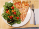 Thin pizza with side salad
