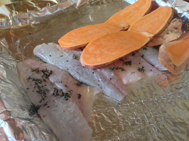 Fish partialy covered with sweet potato